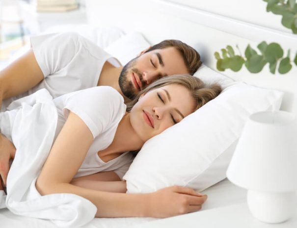 couple sleeping in comfortable bed